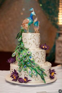 Peacock wedding cake #peacockweddingthemes #peacockweddingcakes
