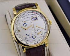 A. Lange & Söhne - Lange 1 Time Zone, ref.116021 - Manual-winding, cal.L031.1, 3Hz, 72hr p.r., second, 12hr hand,day/night indicator on both hands, date, power reserve indicator - 42mm, rose gold case, silver dial ~30k