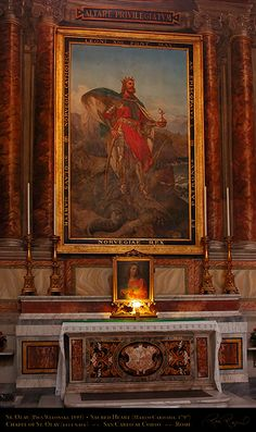 The Chapel of St. Olav of Norway, dedicated to the martyr king killed in the Battle of Stiklestad (1030). Olav stands atop a dragon (representing his victory over his Viking past), holding a golden orb with a cross representing his conversion to Christianity. Painted by Pius Wleonski. The Sacred Heart below St. Olav was painted by Marco Carichia in 1797. The relics of the Roman martyr Saturninus are below the altar.
