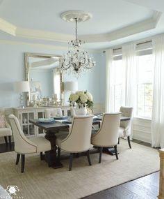 Hanging a rectangular mirror vertically instead of horizontally gives the appearance of tall ceilings - Kelley Nan