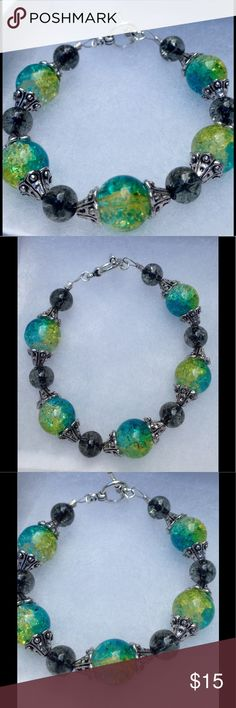 "Green and Black Glass Bracelet This gorgeous bracelet is made with sparkling green-blue and black beads. It will fit a 7 to 7.5"" wrist and attaches with a silver tone toggle clasp.   All PeaceFrog jewelry items are handmade by me! Let me know if you need me to adjust the size. Take a look through my boutique for coordinating jewelry and more unique creations! PeaceFrog Jewelry Bracelets"