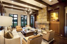 Contemporary Living Room with Chandelier, Hardwood floors, Restoration Warehouse Uni Chandelier, Exposed beam, High ceiling