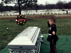 Marine in training at his fathers funeral..