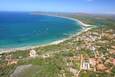 Costa Rica aerial photo of Playa Tamarindo and Playa Grande showing the town and beach of Tamarindo and the pacific ocean.