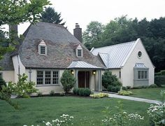 love the sloping roof; stucco walls; copper ; window trim ...