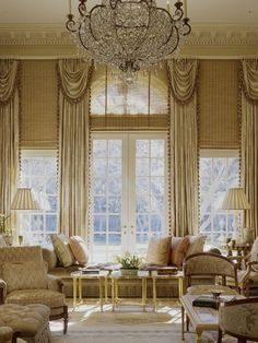 This window treatment is spectacular with a combination of woven wood shades and exquisitely gorgeous luxurious draperies.