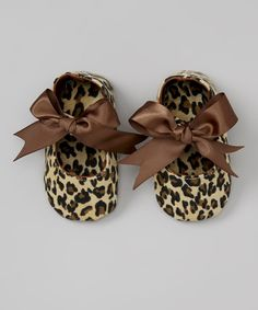 Slip some wiggly little toes into these satin treasures for the beginning of a truly special outfit. Darling bow accents add an extra ounce of style to these treats for tiny feet. 100% polyester upperMachine wash; tumble dryImported