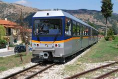 Kalavrita Express, Peloponnese    The openair railway navigates 14 bridges and tunnels, ascends steep slopes, and glides along the rushing Vouraikos River, providing no end of thrills. The beaches of Diakofto are at one end of the route, the pleasantly cool mountain town of Kalavrita at the other.    Photo Caption: The train from Diakofto to Kalavrita, Greece.    Photo by g7ahn/Flickr.com