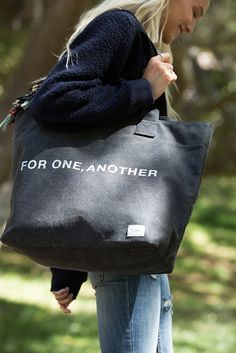 Carry the message wherever you go with a canvas TOMS Tote Bag.