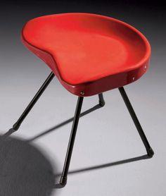JEAN PROUVE (1901-1984) TABOURET, VERS 1952 En aluminium laqué couleur rouge corsaire, l'assise moulée, reposant sur quatre pieds tubulaires laqués noir, terminés par des patins en caoutchouc Hauteur : 42,5 cm. (16¾ in.) ; Largeur : 44 cm. (17¼ in.) ; Profondeur : 35,6 cm. (14 in.)