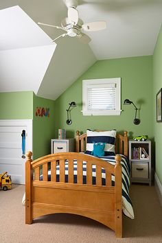 """similar for Jasper, in the """"Look, green walls, white trim, white & navy striped bedding! Looks awesome!"""" kind of way. (Though I think the green he wants is a smidge deeper)."""