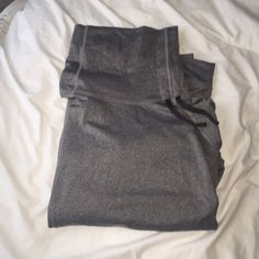 Nike running shirt Gray Nike, dry fit, running shirt. Has a turtle neck with strings. Nike Tops