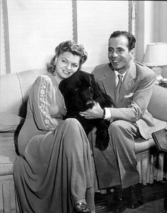 """Humphrey Bogart and his third wife, Mayo Methot, with their black Newfoundland dog, """"Cappy,"""" at home, circa 1944."""