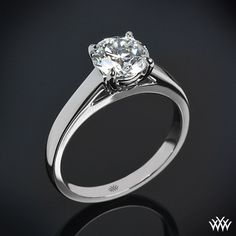 "A captivating piece of art, this ""Flush-Fit Cathedral"" Solitaire Engagement Ring is the perfect choice for those who love subtle sophistication. Two surprise diamonds rest in the gallery of the head (0.07ctw) and the ""Flush-Fit"" design ensures a snug fit with your wedding band. Is a great match to our ""Flush-Fit"" Diamond Wedding Band. The width tapers from 2.6mm at the top down to 2mm at the bottom. ..."