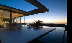 A minimalist First Crescent residence was designed by Stefan Antoni Olmesdahl Truen Architects (Saota) in Camps Bay, South Africa.
