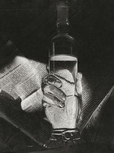 Herbert List - Bottle with Newspaper. France, Paris 1936. S)