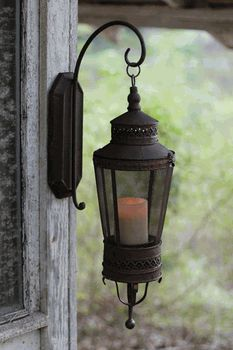 Rustic Metal Wall Sconce Lantern... some like this to flank the elk on the fireplace
