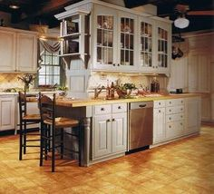 """Fiber floors? interesting. but I also like the HUGE island in this kitchen! it's like 4 china cabinets mixed into one giant """"thing"""""""