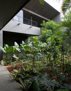 Called Gomati, the house is located between Mumbai and Pune in the Indian state of Maharashtra.    It was designed by Mumbai studio Spasm Design, which previously created another house in the region using concrete mixed with local basalt stone.