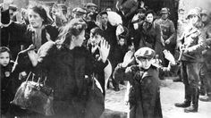 """Jews being rounded up after the collapse of the Jewish Warsaw Ghetto uprising in May of 1943 by the cruel ghetto guard Josef Blösche (right) [termed """"Frankenstein""""] who helped provoke the revolt  Henry Beville - collection of Dr. Alexander Bernfes, London"""