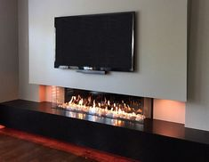 Fireplace gallery, tv over fireplace, fireplace shelves, linear fireplace, Fireplace Gallery, Fireplace Tv Wall, Linear Fireplace, Fireplace Pictures, Black Fireplace, Fireplace Inserts, Living Room Tv, Living Room With Fireplace, Living Room Modern