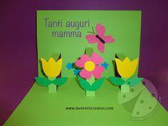 BIGLIETTO D'AUGURI CON FIORI Un semplice biglietto pop up con fiori da regalare alla vostra mamma per il giorno della sua festa. Biglietto con fiori Materi