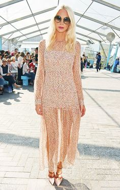 Poppy Delevigne wears a printed chiffon dress with pointed toe heels