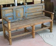 Bench made by recycling an unusual old door for the back...love the touch of worn blue paint with the brown stain...