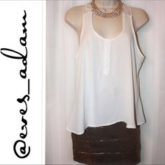 Racer Back Chiffon Tank This chiffon Racerback tank features. A delicate flowy bodice with a beautiful crochet tulle. Three white buttons in the front. Fits perfectly for any stylish comfortable style. Pair with your fav skinny jeans. nEw without tags. Great for any occasion. Arise Tops