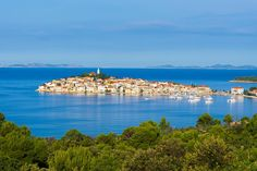 Primošten is a small town situated between Šibenik and Trogir in Dalmatia region. It offers a typical Mediterranean landscape with charming narrow streets, densely built traditional village houses, wooden boats and pristine beaches. Just as the town of Trogir, the old town of Primošten was... - https://www.welcome-to-croatia.com/holiday-destinations/primosten/