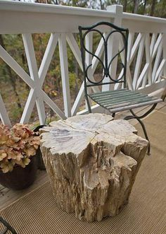Paul Michael Company side table made from a petrified wood. If you have a tree trunk you'd like to transform into a table allow it to dry for a month, remove the bark, and then coat in polyurethane.