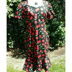 """VINTAGE Cherry Print Ruffle Bottom Dress Quite possibly new old stock from 80s/90s, doesn't appear to have been worn. Fun spring cherry print on black. Be daring and wear it for some color in the fall with a shawl. There is a godet inserted for dancing fun!  No size tag, guessing a large. Best fit for a 8-10. 35% cotton, 65% polyester.  Measurements:  Pit to pit : 20"""" Shoulder : 15.5"""" Neck : 8"""" Waist (narrowest) : 17.5"""" At start of ruffle : 20"""" Length : 41"""" Vintage  Dresses Midi"""