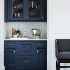 navy cabinets, pearlescent tile, wire screens on upper cabinets. -idea: blue cabinets with white marble counter tops. Navy Cabinets, Blue Kitchen Cabinets, Upper Cabinets, Kitchen Backsplash, Colored Cabinets, Kitchen Island, Painted Cabinets In Bathroom, Wet Bar Cabinets, Grey Cupboards
