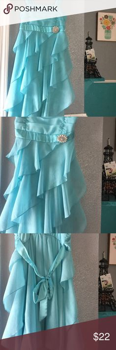 A elegant girls dress 👗 Gorgeous Tiffany blue dress with a beautiful pin on the side worn once no flaws except for very very light stitching area in one of the straps cannot tell at all -if you have any questions about this item feel free to ask (this makes a perfect dress for a spring/summer wedding or party; perfect for that classy girl (can fit a size 10) bcx girls Dresses Formal