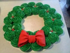 Christmas party idea, cupcake wreath. This could be fun and no forks needed :)