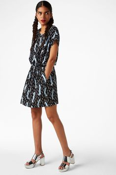 <p>Just try it. Really. This shirtdress lands so well on the figure, especially with the drawstring waist with silver stoppers. Hidden pockets.</p> <p