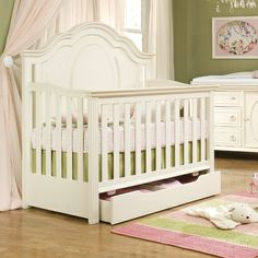 love the storage drawer underneath the crib... that is, until the 'curious' child finds it!