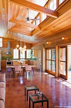 strawbale house design -love the floors ceiling, wood interior and windows open plan living space