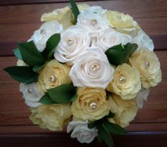Yellow and creme roses, with crystal inserts bride bouquet. #ivoryyellowbridebouquet #ivoryyellowrosebouquet #rosecrystalbouquet #mybouquetlv