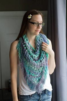 Spring Crochet Fringe Boho Triangle Scarf ♥ by Fibreandfabrics ♥ I'm dreaming of Spring with this light and airy fringe scarf! This can be worn either as a triangle scarf or shawl for a cool Spring or Summer night. The versatility of the open mesh crochet work allows for this to be fashioned in many different ways without the need for buttons!  #crochet #etsy