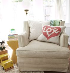 I love the pillow!  Just watched this kind of pillow spray-painting on the Today show....