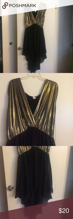 Gold & Black sleeveless gown This dress is full of Fun with its flirty , flowy, shear bottom and sexy deep v cut golden top. Fashion to Figure Dresses Asymmetrical