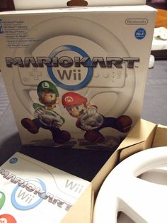 Jeu Wii MARIOKART +  volant + manette + protection manette - TBE