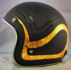 Black on Black with some Gold. Not D.O.T Approved Motorcycle Helmet. -Crown Helmet.
