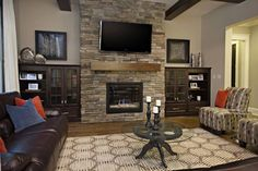 Contemporary Living Room Decorating With Leather Sofa And Stone Fireplace Tv On Top