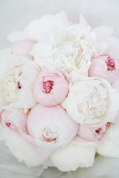 White and delicate pink peonies together.