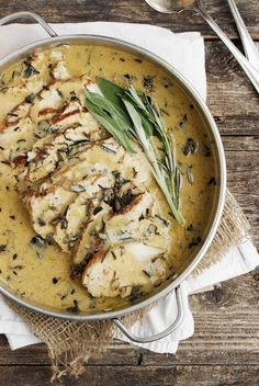 Pork loin recipe, cooked with white wine and sage and rosemary, then sliced and served with a lightly creamy gravy.