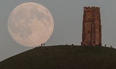 (Blue moon = 2 full moons in one month) The moon rises over people gathered on Glastonbury Tor, Somerset, England on July 30, 2015. Tonight it will happen again and be called a Blue Moon. The last time this happened was in 2012 and there isn't due another until 2018.