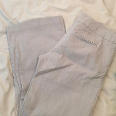 "Gap Hip Slung Fit- Flared Leg - size 10 Grayish white striped Hip slung fit pants. Flared leg. 27"" inseam 2 rear pockets. Button detail in each hip. No belt loops. GAP Pants Boot Cut & Flare"
