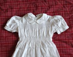 Very pretty embroidered and smocked romper by FrenchArtAndHeritage